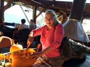Cornelia Seckel carvin a pumpkin at the restaurant Nepenthe in Big Sur