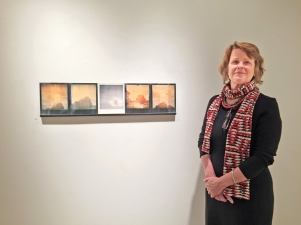Lori Van Houten with one of the paintings from the Reverse Migration & Other Stories exhibit at R&F Paints, Kingston, NY