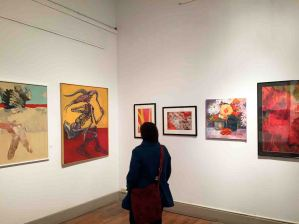 The Art Society of Kingston gallery a visitor to the Seeing Red, a group show of ASK members