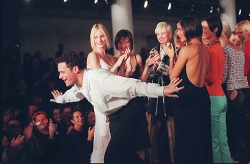 Isaac Mizrahi takes a bow on the runway with his models at the showing of his 1997 Spring collection in New York Thursday Oct. 31, 1996. (AP Photo/Bebeto Matthews)