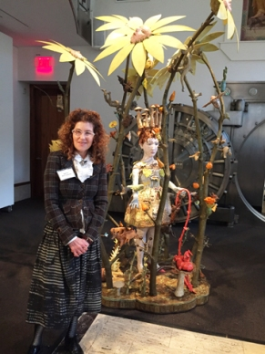 "Kathy Ruttenberg with her sculpture ""Nature of the Beast"""