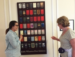 Our guide Cecily shows Heidi the Poster of Edith Wharton's 40 first editions