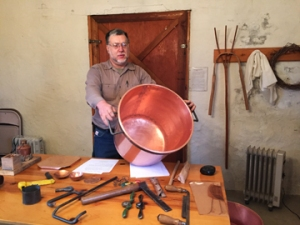 Kevin Riddle helps preserve his Appalachian Mountain culture through authentic traditional rustic wood working and hand hammered coppersmithing