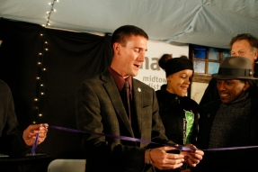 Kingston Mayor Steve Noble cutting the ribbon at the Midtown Arts District opening celebration