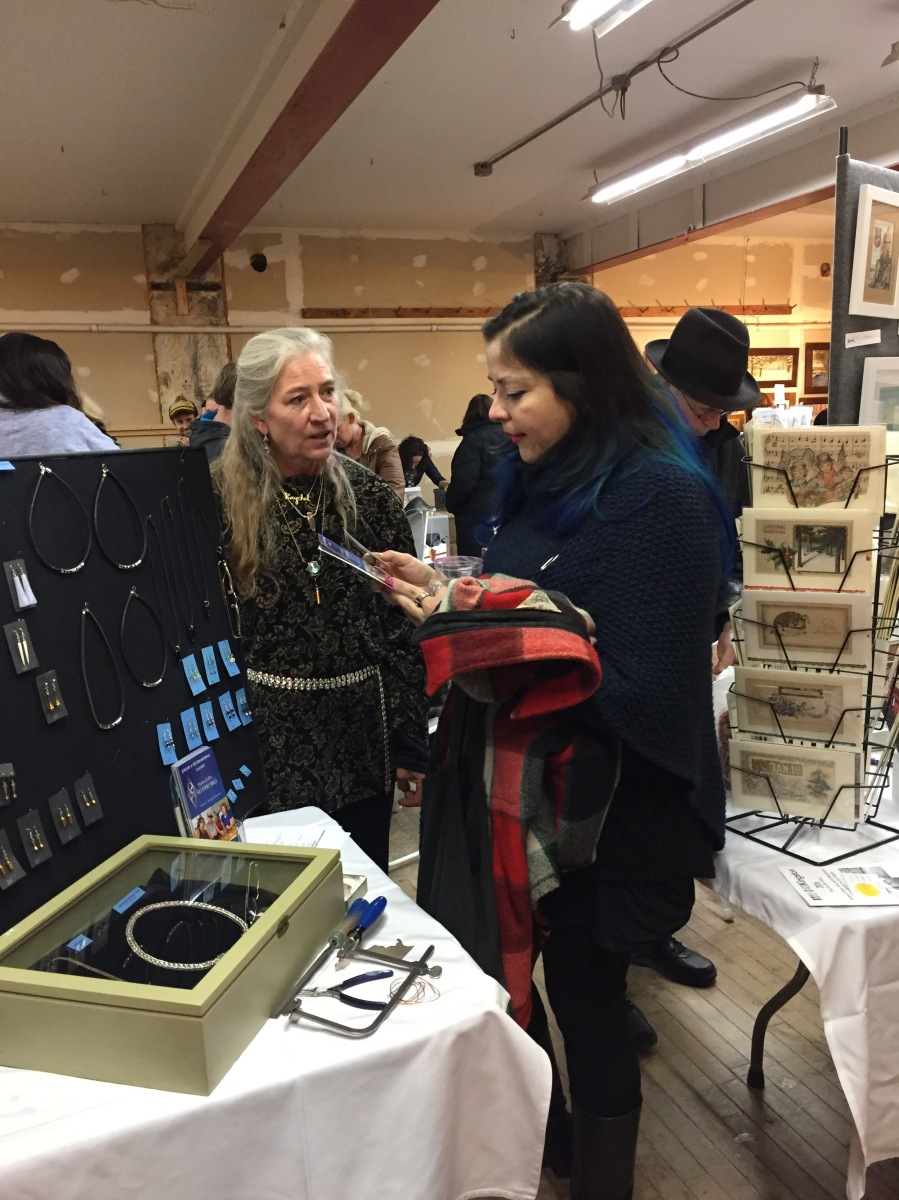 Raychel Wengenroth speaking with a customer at the Made for Kingston event